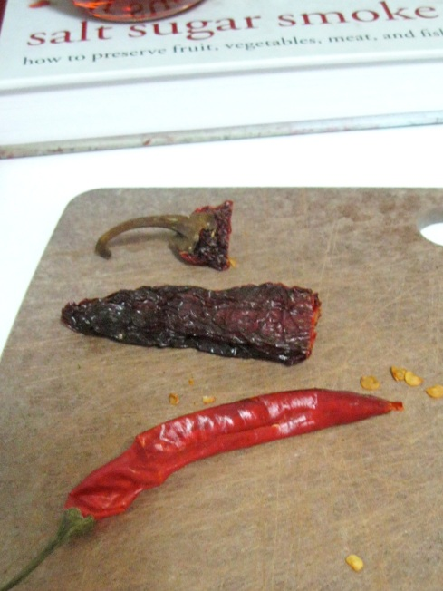 Dried chipotle chiles (above, with stem removed) and chiles de arbol (below).