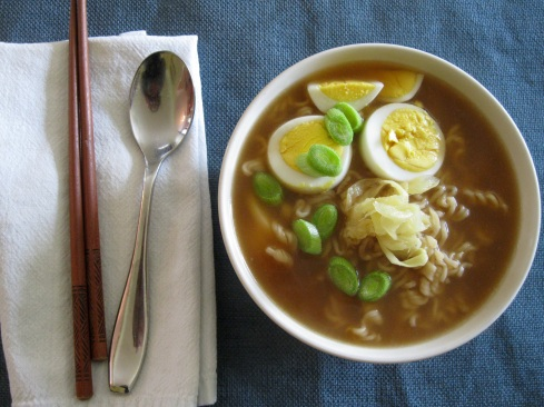 Top Ramen with boiled egg, fresh garlic stems, and pickled ginger.