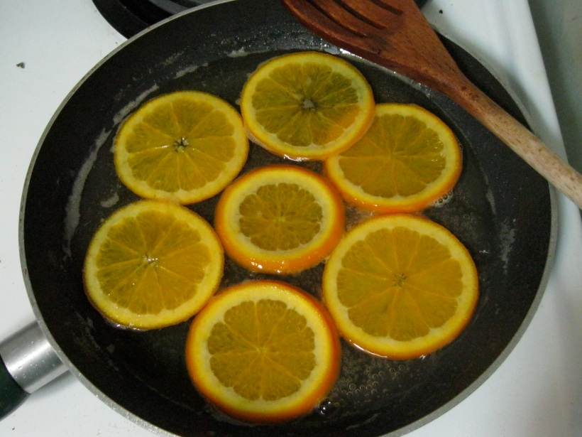 Oranges simmering in sugar and water. This was taken about half-way through the recipe.