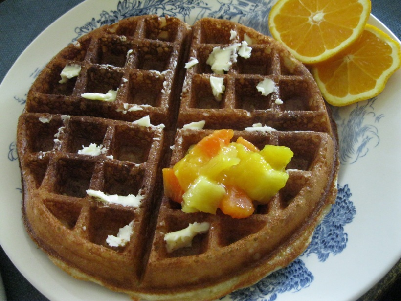 Waffle with butter and tropical fruit compote.