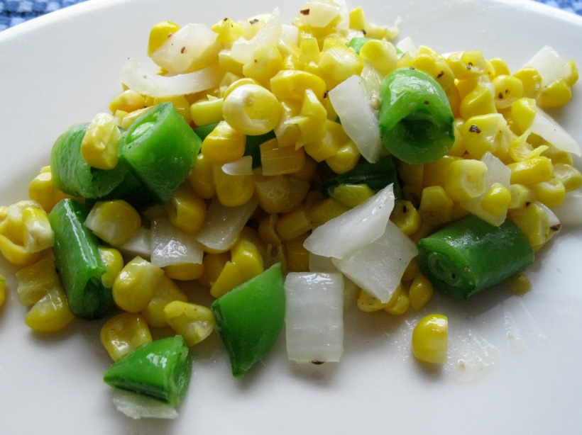 Corn sauteed with onions and peas. A great summer side dish!