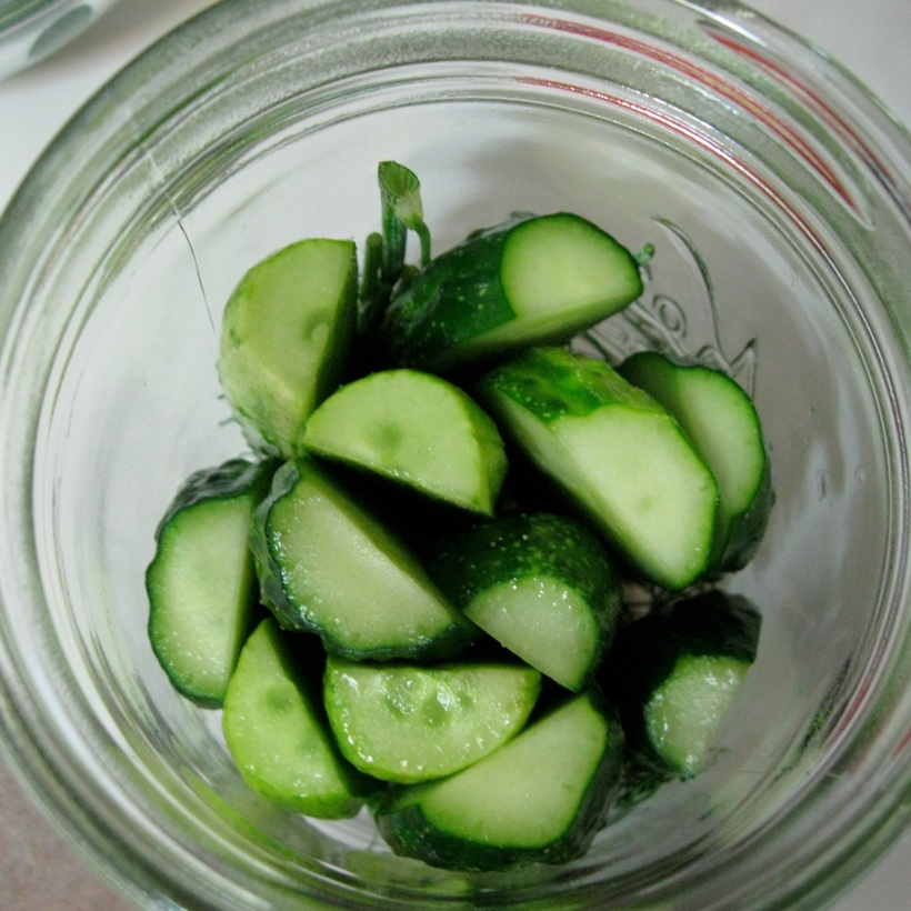 Fill the jar with cucumbers, but don't squish them in.