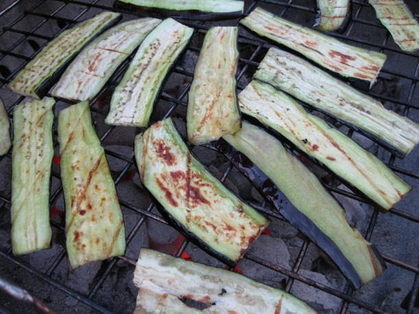 After drying and brushing with oil, set eggplant on the grill.