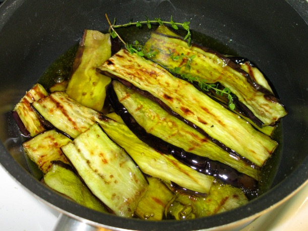 Eggplant, oil, vinegar, and thyme on the stove.