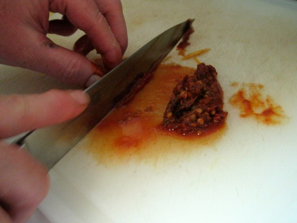 Slicing the chipotle pepper. You also add some of the adobo sauce from the can.