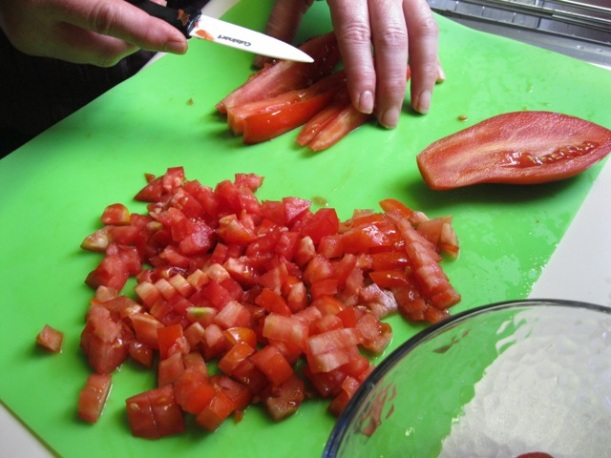 Dicing the tomatoes.