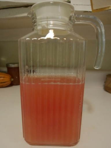 And here's the full amount of juice. Why is it pink when the quince are yellow, you ask? I am not sure. The only reason I can think is that the apple had red skin, but that doesn't seem like enough. Must be something in the quince.