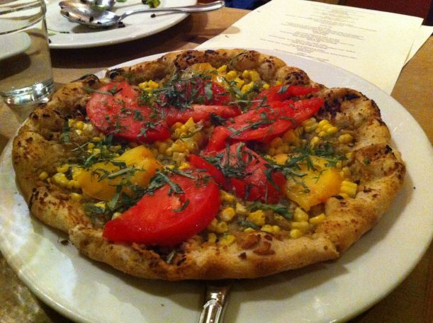 Heirloom tomato with sweet corn pizza - vegan. I sort of wished there were cheese on it, but that's just a universal truth with me.