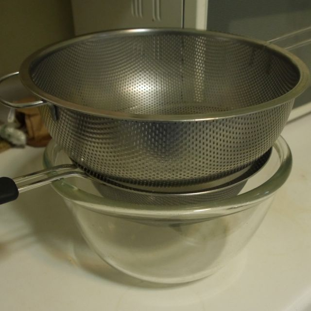 This is my set up for straining fruit for jelly. I put the cooked fruit and juice in the top colander, which drains into the sieve, which drains into the bowl. If you don't have cheese cloth this works very well.