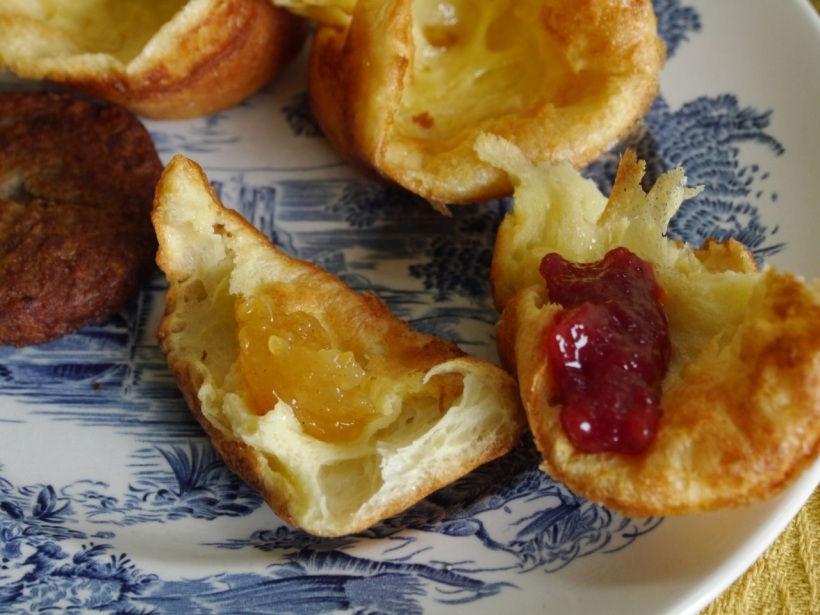 Popovers, ready to eat! The left has peach with cardamom jam, and the right has strawberry jam.