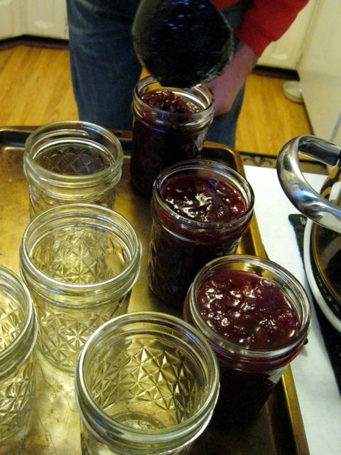 Here we are pouring the jam into jars. Jason and his wife and I all got to take turns at this point, and the jam was firm enough that it didn't drip at all!