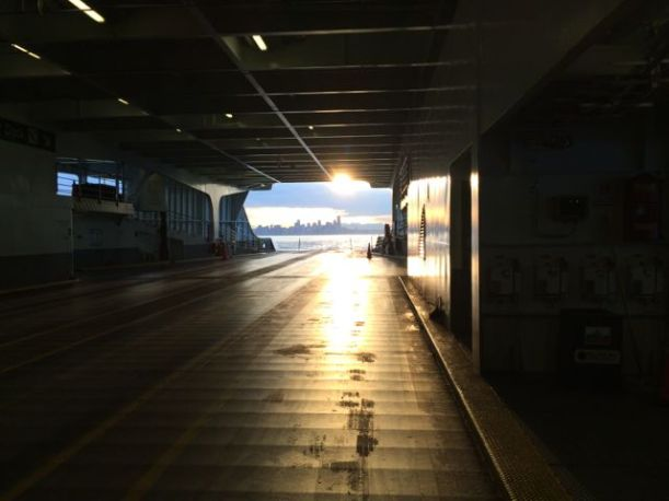 Looking back to Seattle from a half empty ferry. The return ferry will be filled with commuters.