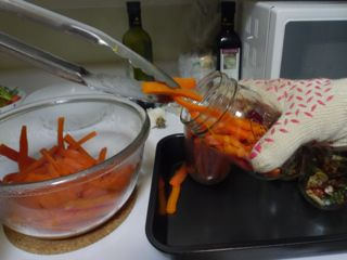 Loading carrots into jars. This is hot business!