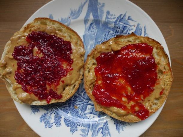 Raspberry jam (left) and strawberry jam (right). I made these a week apart in a very productive moment last summer.
